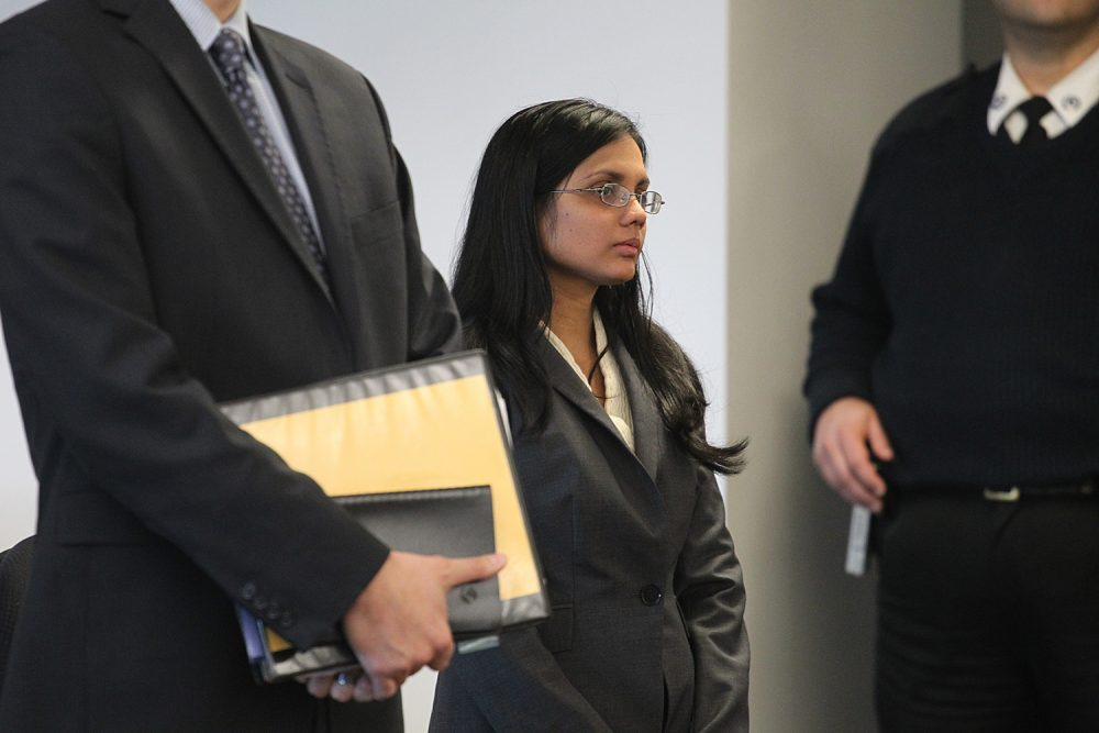 Former state lab chemist Annie Dookhan, center, stands in Middlesex Superior Court for arraignment in 2013. (Suzanne Kreiter/The Boston Globe, Pool via AP)