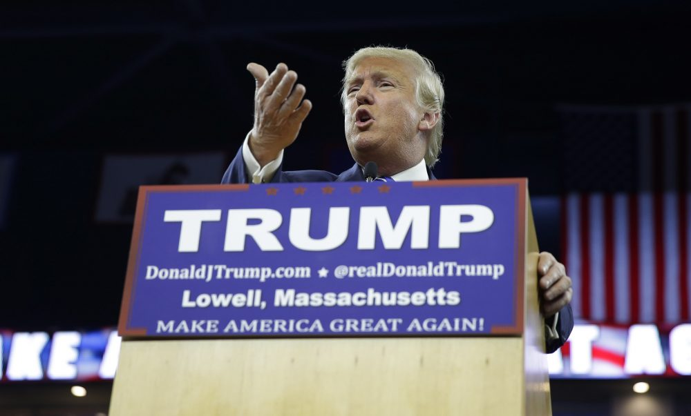 In this file photo, then-Republican presidential candidate Donald Trump gestures during a campaign stop at the Tsongas Center in Lowell on Jan. 4, 2016. (Charles Krupa/AP)