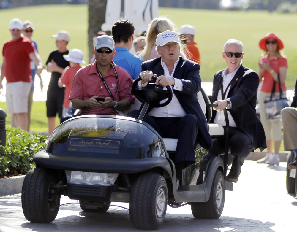 Any foreign money Trump receives, in any form, could violate the Constitution's emoluments clause -- which prohibits government officials from taking money or gifts from a foreign state -- as alleged in the lawsuit filed last week by a group of ethics experts and legal scholars. In this March 6, 2016, file photo, Republican presidential candidate Donald Trump, right, drives himself around the golf course to watch the final round of the Cadillac Championship golf tournament in Doral, Fla. (Luis Alvarez/AP)