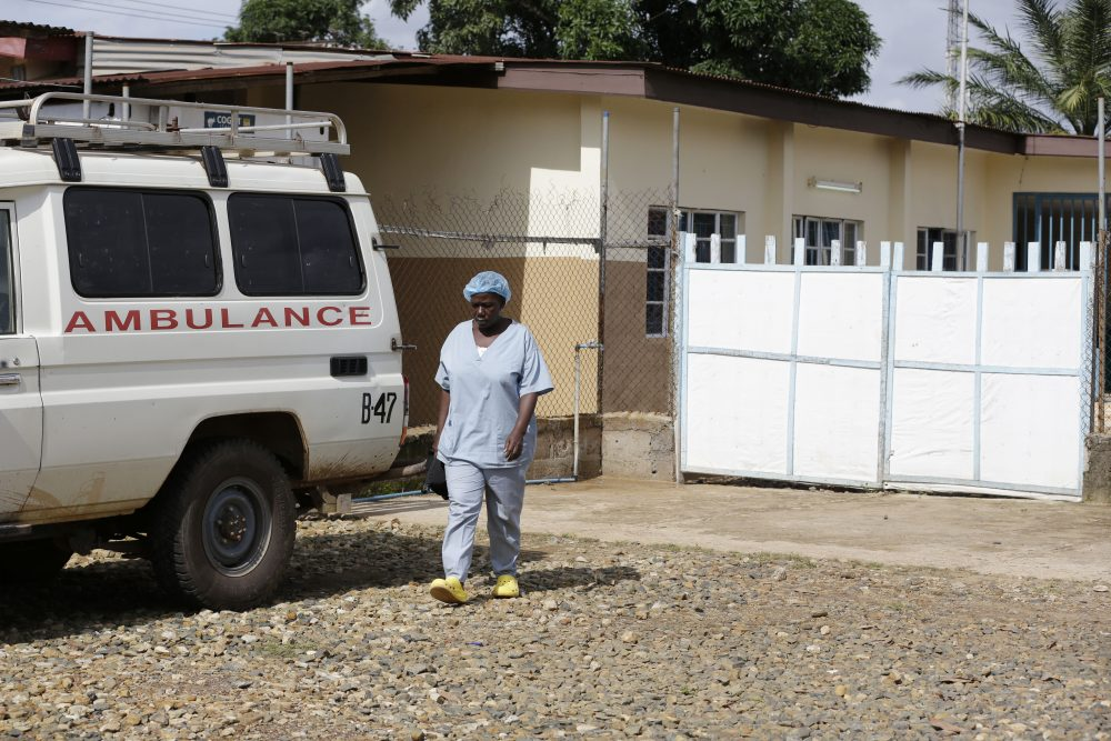 A nurse walks past an ambulance at the government hospital in Kenema, Sierra Leone, during the Ebola outbreak. (Sunday Alamba/AP)