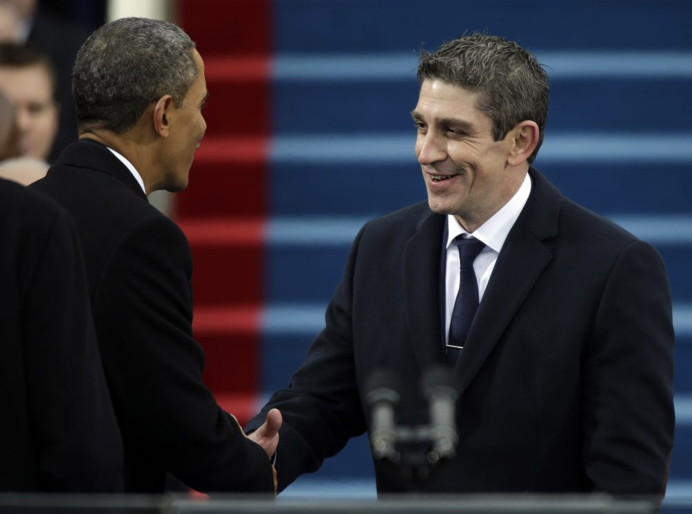 President Barack Obama, left, shakes hands with poet Richard Blanco during the 57th Presidential Inauguration in Washington, Jan. 21, 2013. (Pablo Martinez Monsivais/AP)