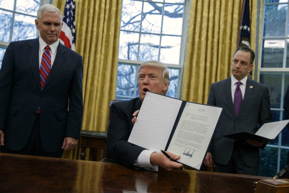 It's allowable, and necessary, for a president to change his mind in light of evidence, writes Rich Barlow, or when he's won his election and doesn't need to pander. Pictured: In this Jan. 23, 2017, photo, Vice President Mike Pence, left, and White House Chief of Staff Reince Priebus watch as President Donald Trump shows off an executive order to withdraw the U.S. from the 12-nation Trans-Pacific Partnership trade pact agreed to under the Obama administration in the Oval Office of the White House in Washington.  (Evan Vucci/AP)