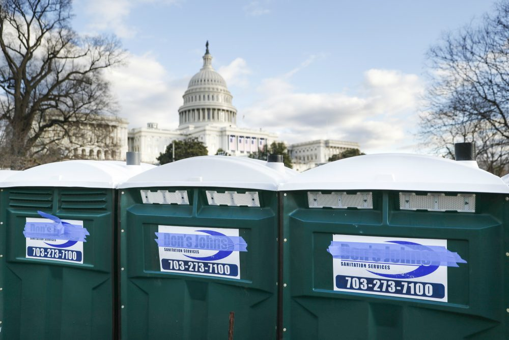 "It was the week before everything changed, writes Tom Keane. Here's 10 news items to remember it by. Pictured: Portable toilets have their brand name ""Don's Johns"" covered with masking tape as preparations continue for Friday's presidential inauguration, Wednesday, Jan. 18, 2017, on Capitol Hill in Washington. (John Minchillo/AP)"