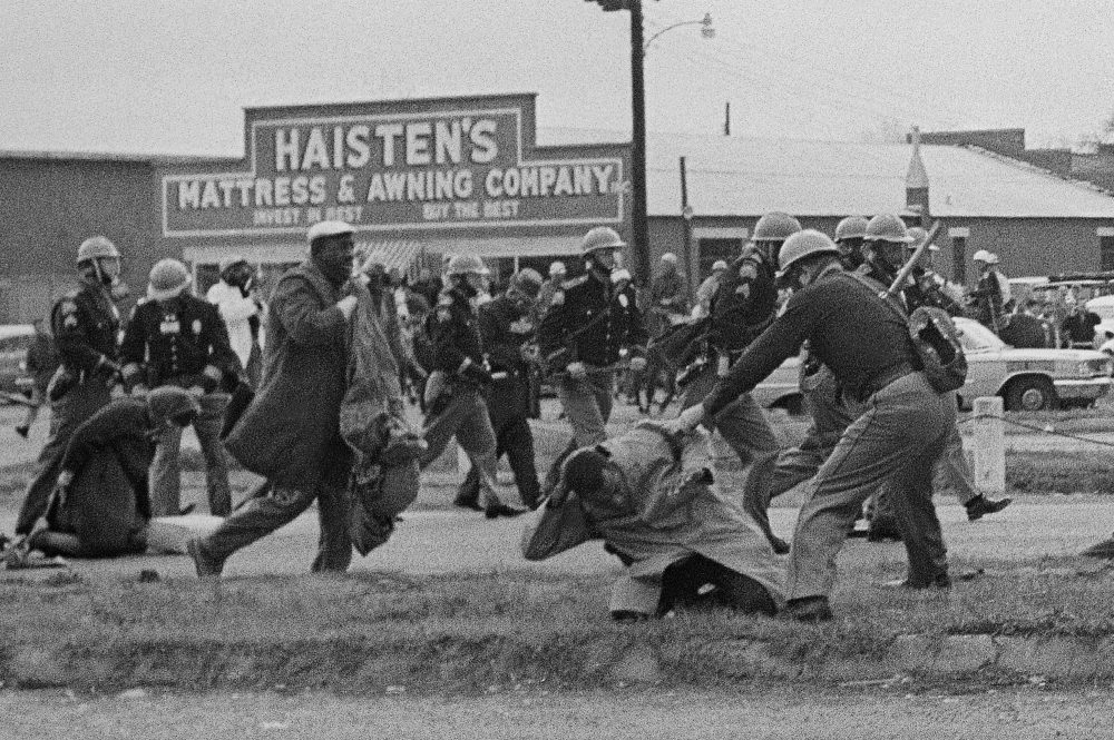 State troopers swing billy clubs to break up a civil rights voting march in Selma, Alabama on March 7, 1965. John Lewis, who was then the chairman of the Student Nonviolent Coordinating Committee is being beaten by a state trooper. (AP Photo)