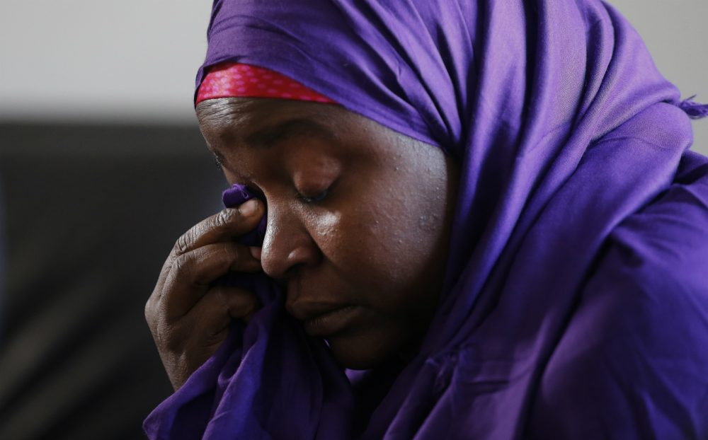 Pictured: Somali refugee Habiba Mohamed wipes away tears as she speaks during a news conference Tuesday, Jan. 31, 2017, in Decatur, Ga.. Mohamed's 20-year-old daughter is unable the leave Somalia due to the travel ban implemented by President Donald Trump. (John Bazemore/AP)