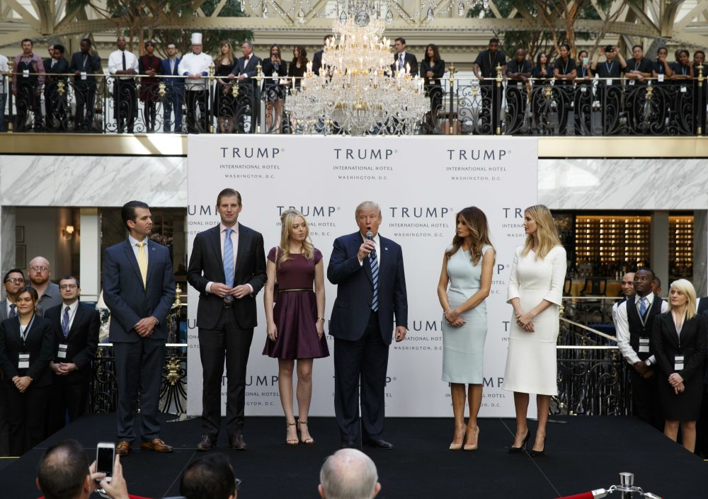 We may never know the extent of his conflicts, writes Wendy Kaminer, but we do know enough to be alarmed. Pictured: In this photo dated Oct. 26, 2016, then-Republican presidential candidate Donald Trump, accompanied by, from left, Donald Trump Jr., Eric Trump, Trump, Melania Trump, Tiffany Trump and Ivanka Trump, speaks during the grand opening of the Trump International Hotel, the old post office, in Washington. A Trump lawyer and an aide have said that the president-elect will set up a blind trust to avoid conflicts of interest, but that is not possible given his plans to hand control of his business to three of his adult children, not a trustee. (Evan Vucci/ AP)