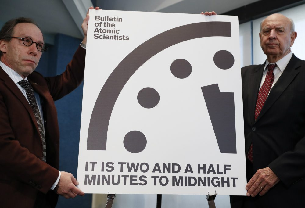 In organizing with those who share in our causes, writes John Vercher, we must begin to forge the bridges of commonality with those who do not. Pictured: Lawrence Krauss, theoretical physicist, chair of the Bulletin of the Atomic Scientists Board of Sponsors, left, and Thomas Pickering, co-chair of the International Crisis Group, display the Doomsday Clock during a news conference the at the National Press Club in Washington, Thursday, Jan. 26, 2017, announcing that the Bulletin of the Atomic Scientist have moved the minute hand of the Doomsday Clock to two and a half minutes to midnight. (Carolyn Kaster/AP)
