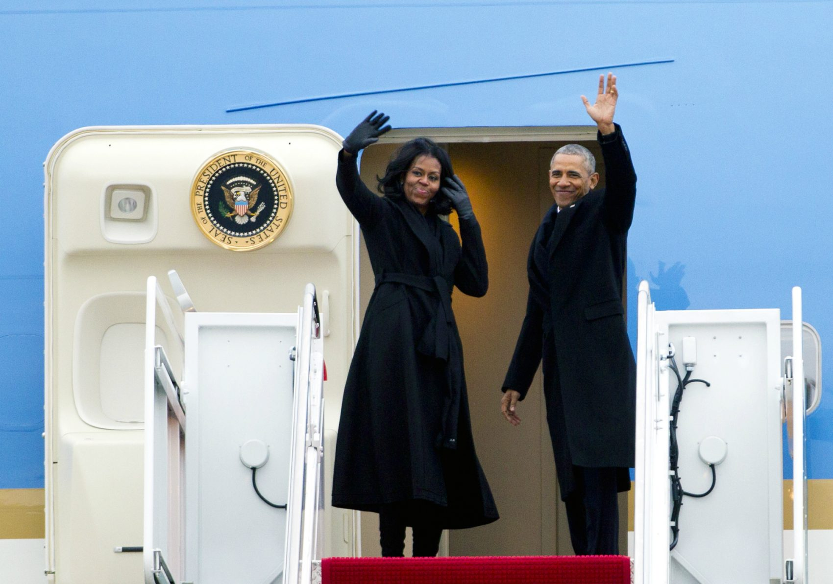 The First Lady's platform, writes Joanna Weiss, has become increasingly powerful, a way to move markets, change minds, and set a standard for a nation full of girls. Pictured: President Barack Obama and First Lady Michelle Obama wave from Air Force One at Andrews Air Force Base, Md., Tuesday, Jan. 10, 2017.  (Jose Luis Magana/AP)