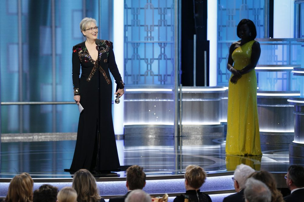 Meryl Streep accepts the Cecil B. DeMille Award as presenter Viola Davis, right, looks on, at the 74th Annual Golden Globe Awards at the Beverly Hilton Hotel in Beverly Hills, Calif., on Sunday, Jan. 8, 2017. (Paul Drinkwater/ AP)
