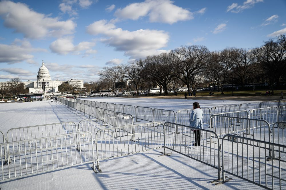 The time has come to stop viewing and start doing, writes Steve Almond. Pictured: A pedestrian stand at the intersection of barricades dividing areas of standing room on the National Mall in Washington, Wednesday, Jan. 18, 2017, as preparations continue for Friday's presidential inauguration. (John Minchillo/AP)