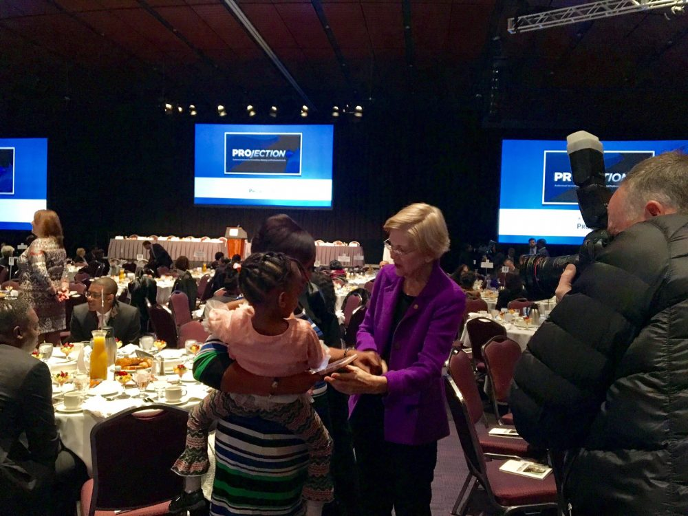 Sen. Elizabeth Warren talks with attendees of Boston's 47th annual MLK Memorial breakfast Monday morning. (Shannon Dooling/WBUR)