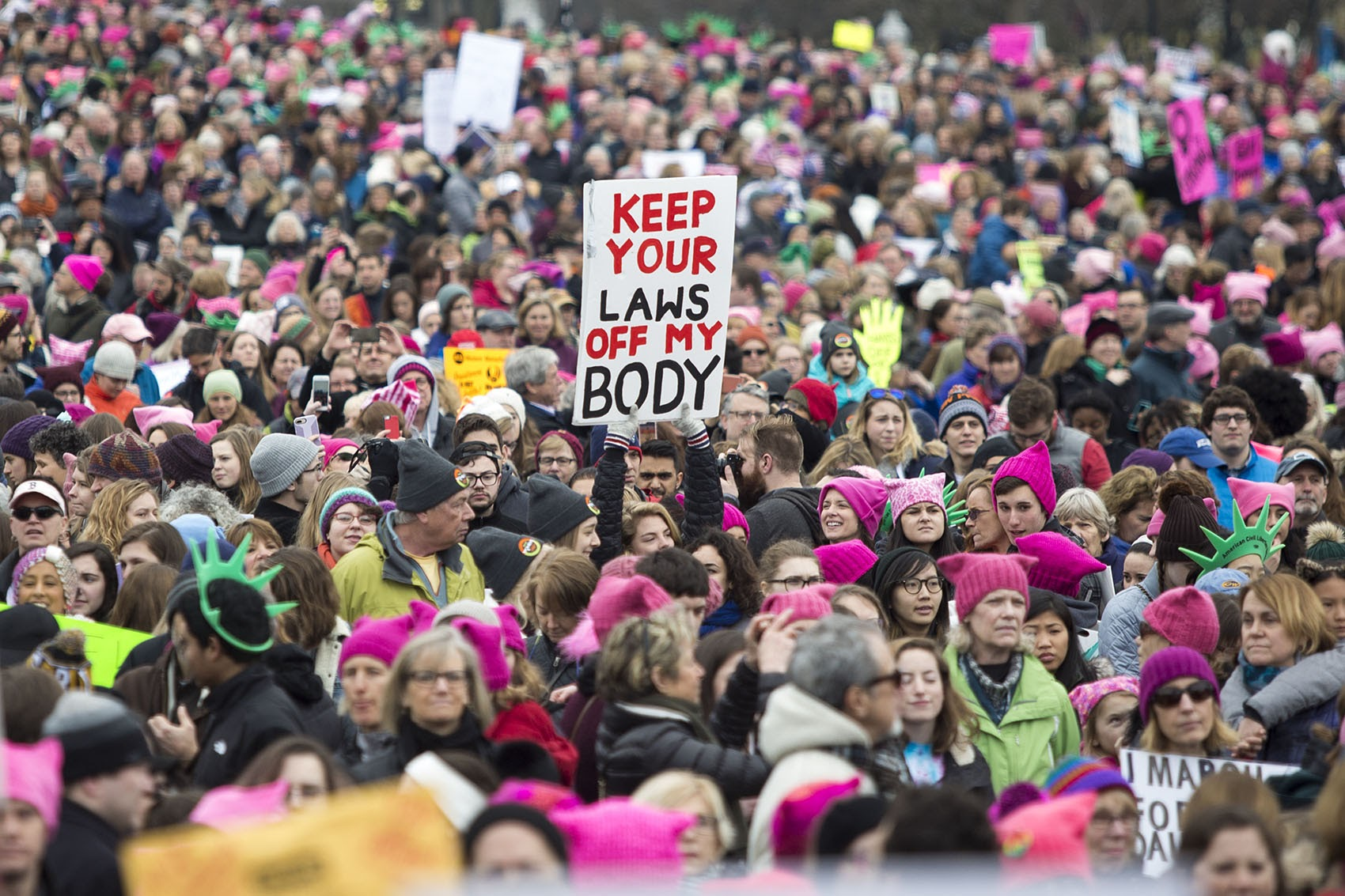 """Pink """"Pussycats"""" stand out at the Women's March in Boston on Jan. 21, 2017. (Jesse Costa/WBUR) (Jesse Costa/WBUR)"""