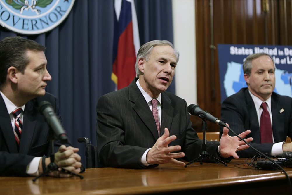 Texas Governor Greg Abbott (center) speaks alongside U.S. Sen. Ted Cruz (R-Texas) (left) and Attorney General Ken Paxton (right) at a joint press conference Feb. 18, 2015 in Austin, Texas. (Erich Schlegel/Getty Images)