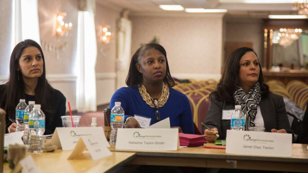 Natasha Taylor-Smith from Montgomery County (center) listens to Anne Wakabayashi, the executive director of EmergePA. EmergePA is a Democratic organization designed to prepare women who want to run for public office. (Emily Cohen for NewsWorks)