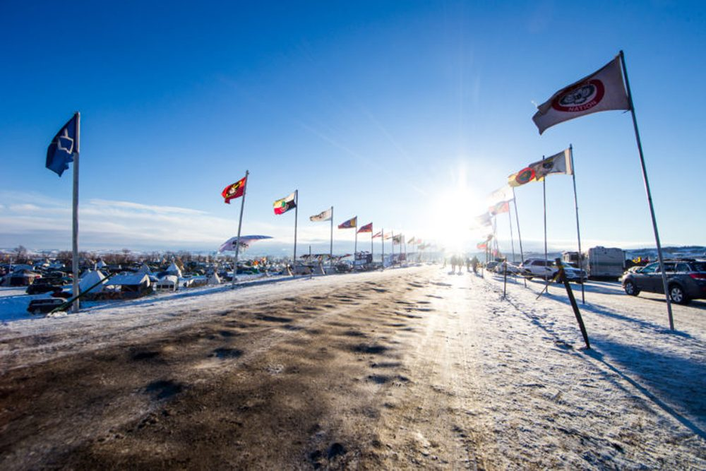 The winter sun shines down Flag Road from the east in the Oceti Sakowin camp where Dakota Access Pipeline protesters settled in for the winter outside of Cannon Ball, N.D. on Sunday, Dec. 4, 2016. (Evan Frost, MPR News)