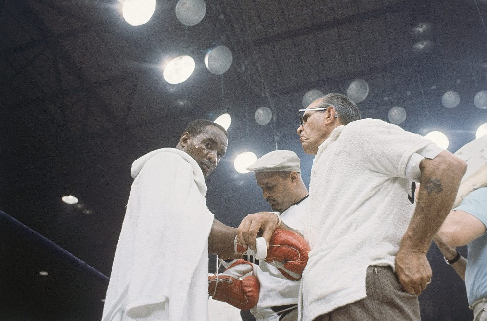 Sonny Liston, left, fought Muhammad Ali in 1964 and 1965. In 1970, he was dead. (AP)