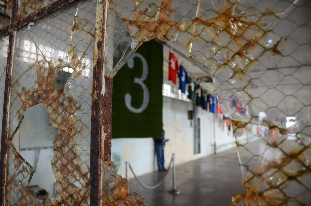 """The art installation """"Shortening: Making the Irrational Rational"""" hangs in the New Industries Building on Alcatraz Island through Sunday, Feb. 5. The piece combines math and prison vernacular to protest long sentences for nonviolent drug offenders. (Ryan Levi/KQED)"""