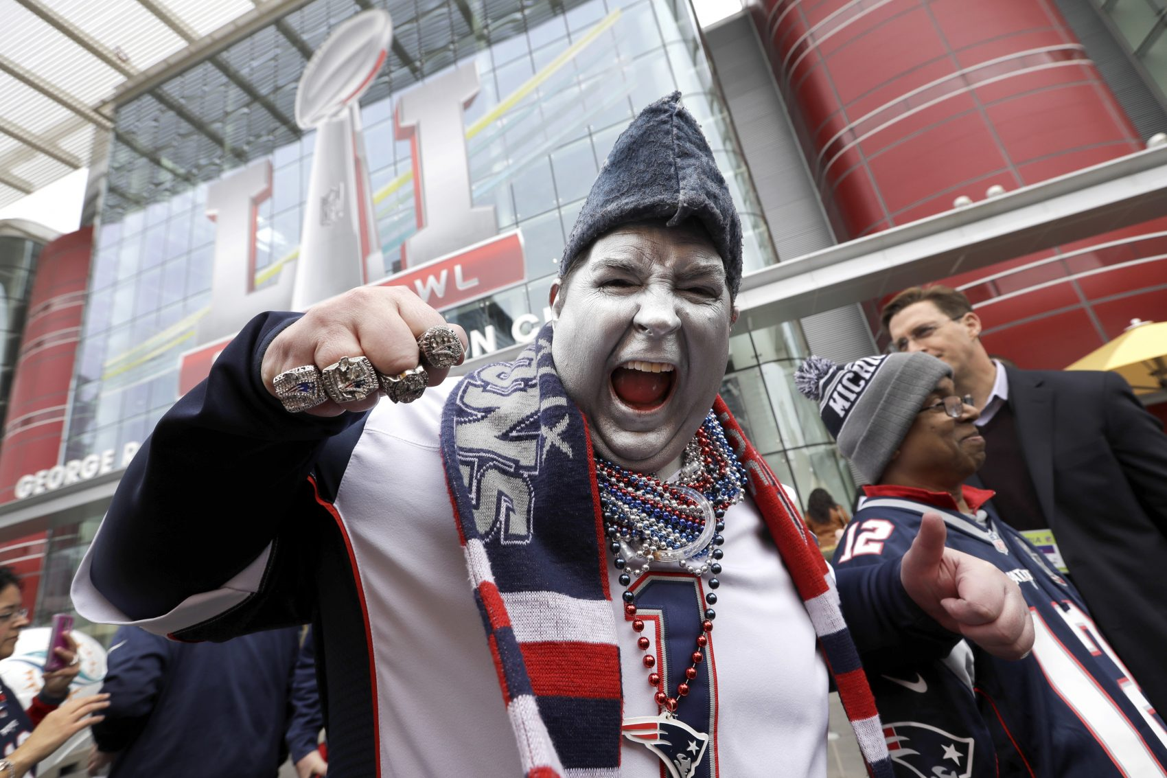 New England Patriots fan Keith Birchall cheers for his team outside the NFL Experience for Super Bowl LI. (David J. Phillip/AP)