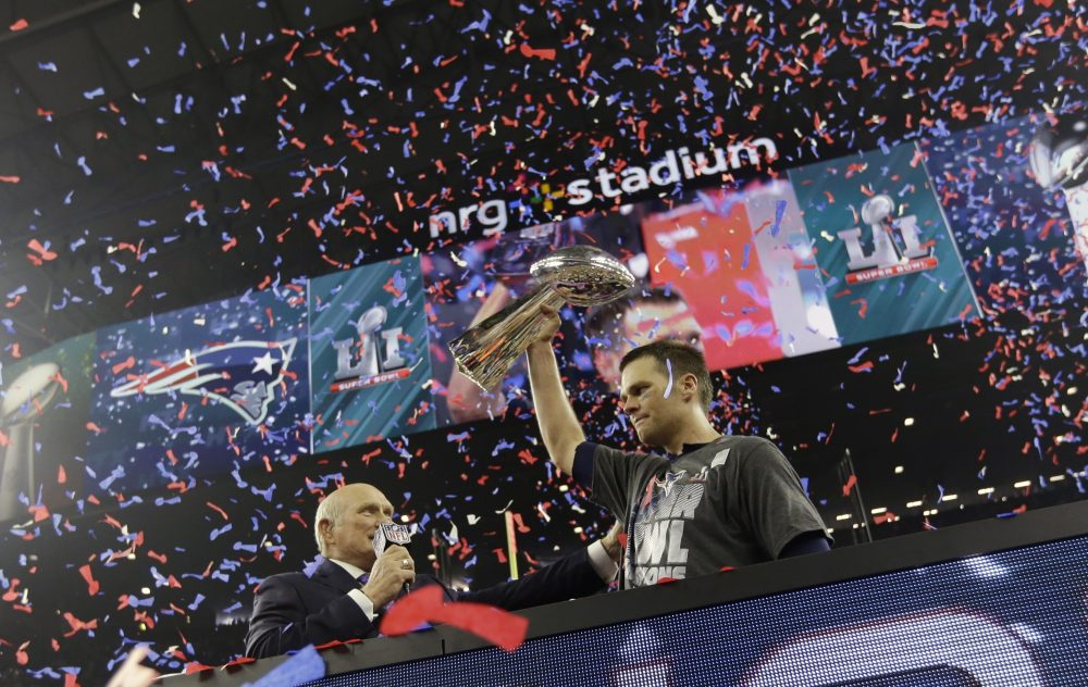 New England Patriots' Tom Brady hoists the Vince Lombardi Trophy after defeating the Atlanta Falcons in the NFL Super Bowl LI in Houston. (David J. Phillip/AP)