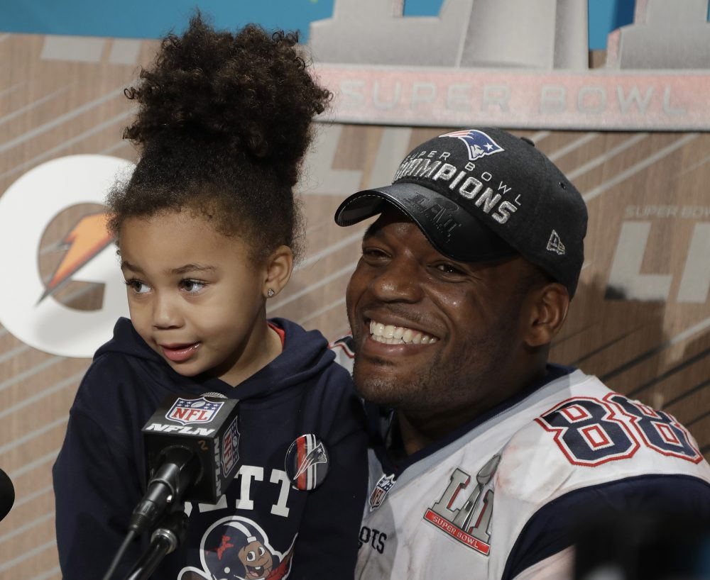 New England Patriots' Martellus Bennett appears at a news conference with his daughter Austyn Jett Rose Bennett after Super Bowl LI on Sunday. (Chuck Burton/AP)