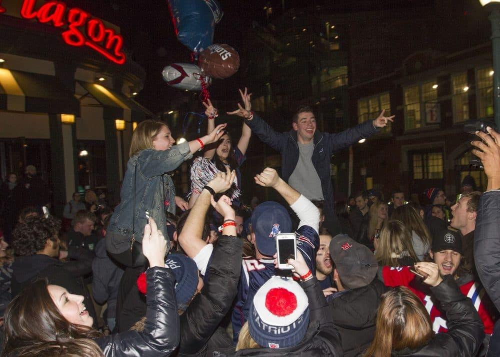 Revelers celebrate outside the bar Cask 'n Flagon. (Joe Difazio for WBUR)