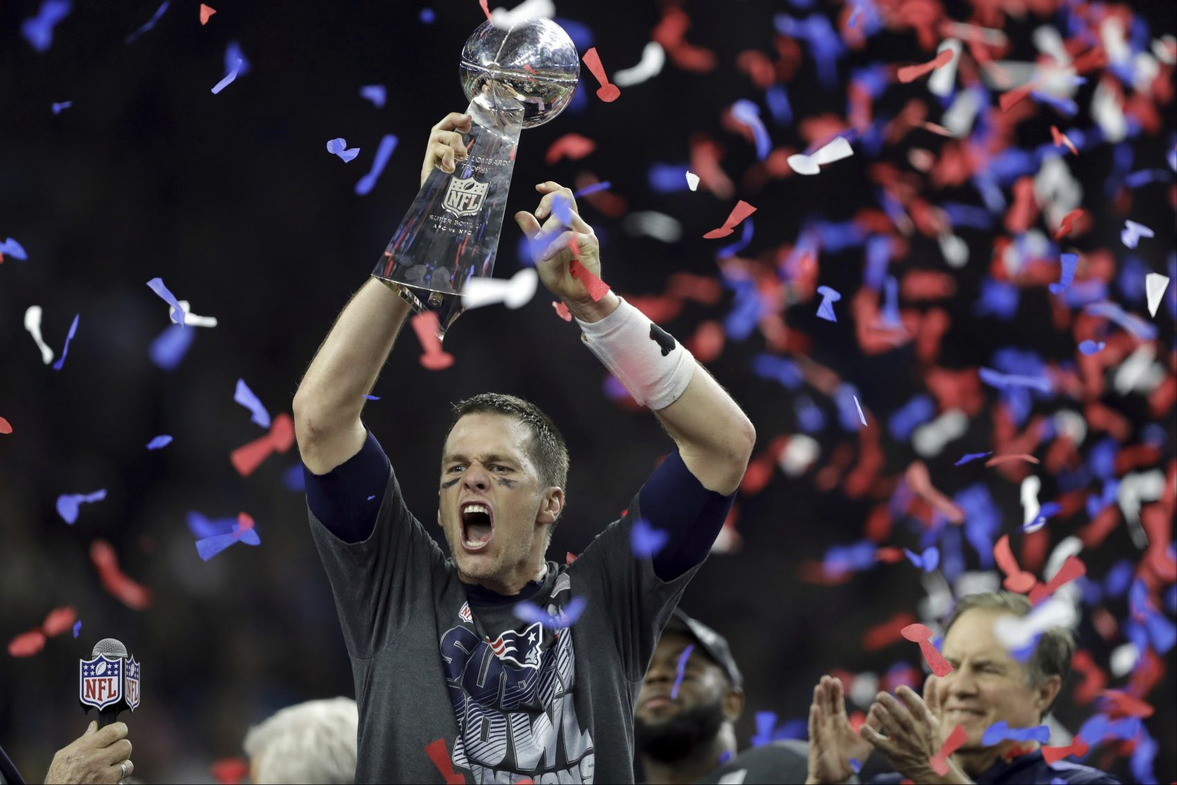 ... New England Patriots  Tom Brady raises the Vince Lombardi Trophy after  defeating the Atlanta Falcons 22ef3c2f7