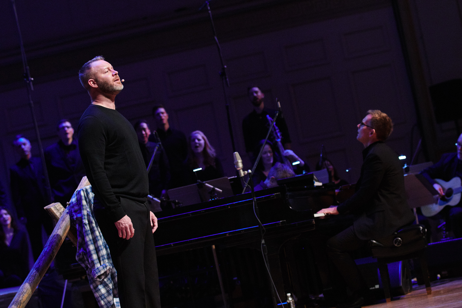 Composer Craig Hella Johnson plays piano as Matt Alber sings at Boston's Symphony Hall. (Courtesy David Green/Berklee College)