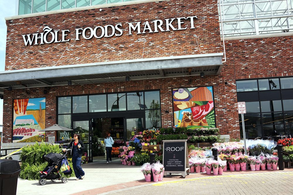 People walk out of a Whole Foods Market in the Brooklyn borough of New York. (Spencer Platt/Getty Images)