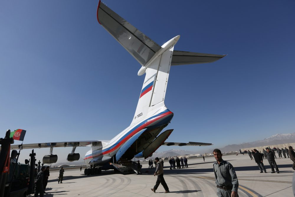 Afghan National Security Forces gather around a Russian aircraft at International Kabul Airport. (Rahmat Gul/AP)