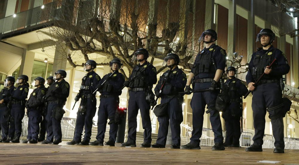 In this Feb. 1, 2017 file photo, University of California, Berkeley police guard the building where Breitbart News editor Milo Yiannopoulos was to speak. (Ben Margot, File/AP)