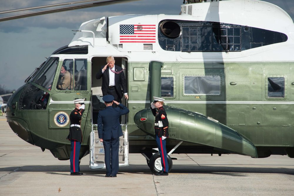 President Donald Trump leaves Marine One before boarding Air Force One at Andrews Air Force Base in Maryland on Jan. 26, 2017. (Nicholas Kamm/AFP/Getty Images)