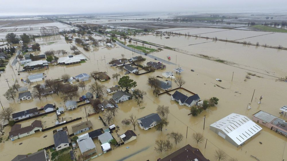 This Saturday, Feb. 18, 2017, aerial photo, shows major flooding in Maxwell, Colusa County, Calif. (Hector Iniguez via AP)