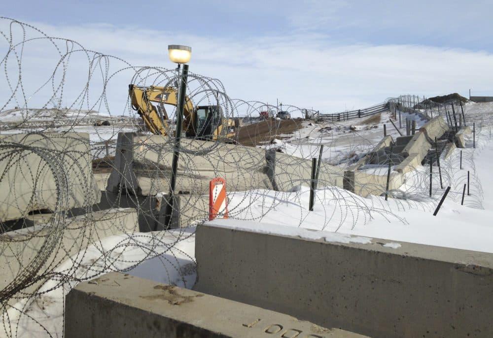 Razor wire and concrete barriers protect access to the Dakota Access pipeline drilling site Thursday, Feb. 9, 2017 near Cannon Ball, North Dakota. (James MacPherson/AP)