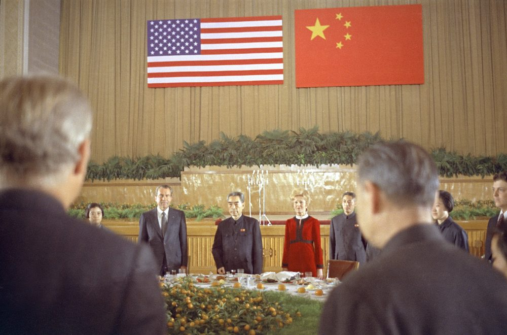 Chinese Premier Chou En Lai is flanked by U.S. President Richard Nixon and first lady Pat Nixon, during a farewell banquet in Shanghai marking the Nixons' last day in China, Feb. 28, 1972. (AP)