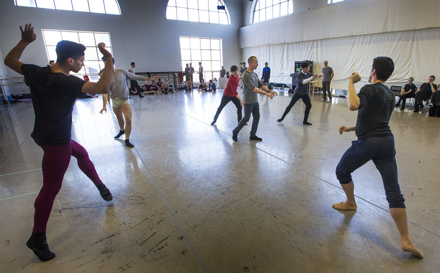 Forsythe guides the dancers through a rehearsal. (Jesse Costa/WBUR)
