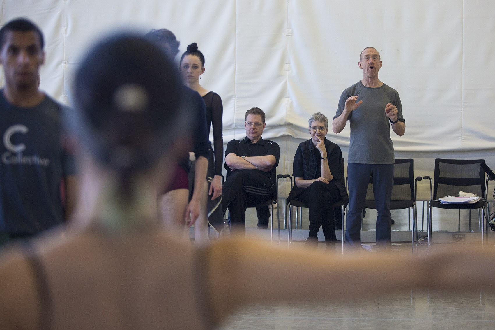 "Choreographer William Forsythe guides dancers through a rehearsal for ""Artifact."" (Jesse Costa/WBUR)"