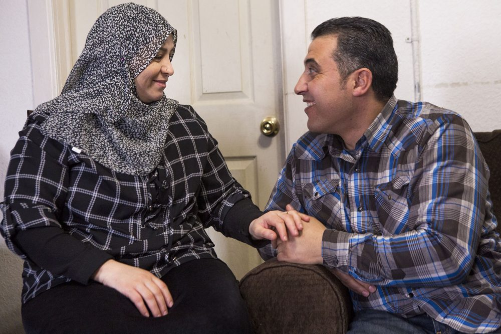 Zenab, left, and Zid Al-Nassar share a laugh in their Westfield home. (Jesse Costa/WBUR)