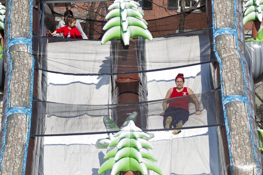 Riding down the Snowzilla slide in Boston Common on Thursday... in a tank top. (Jesse Costa/WBUR)