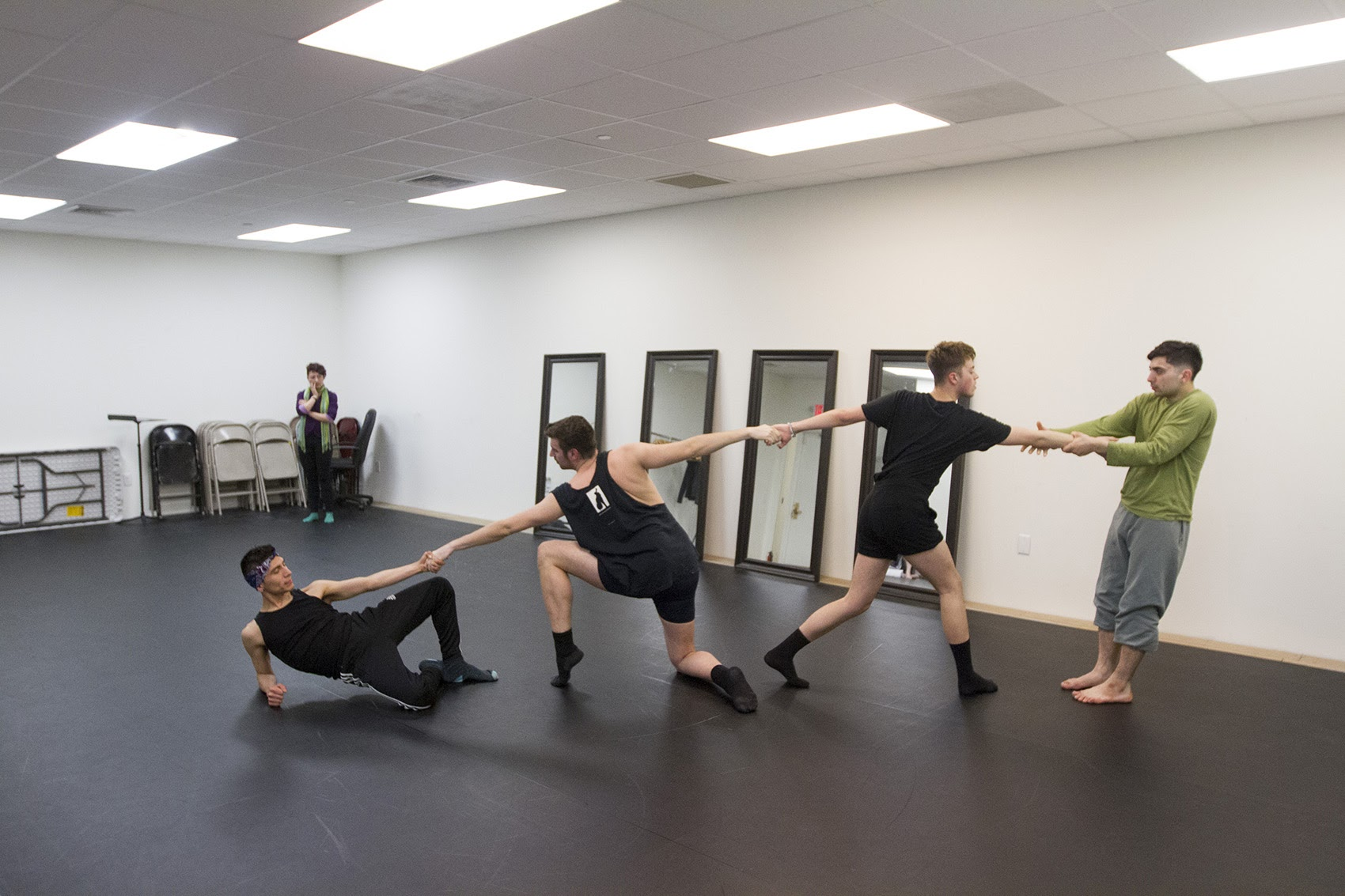 Paradise Lost dance troupe practices in the Lyric Stage Company's rehearsal space on Clarendon Street. (Joe Difazio for WBUR)