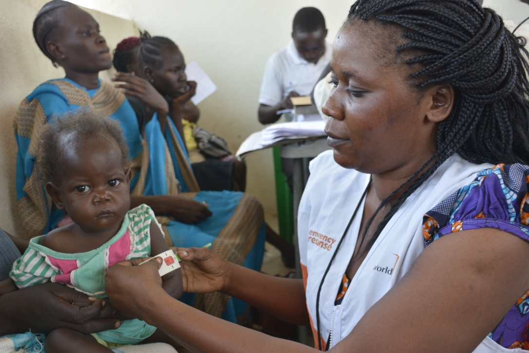 Children undergoing screening for malnutrition at one of the health facilities in Juba where World Vision has an outpatient therapeutic program for malnourished children. The red indicates severe acute malnutrition. (Courtesy Rose Ogola/World Vision)