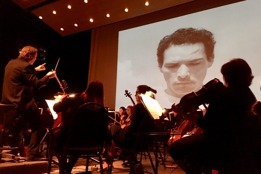 "A screening of the iconic Mexican film ""Redes"" at the Music Unwound festival, accompanied by the El Paso Symphony Orchestra, which performed the score live. (Armando Trull/WAMU)"