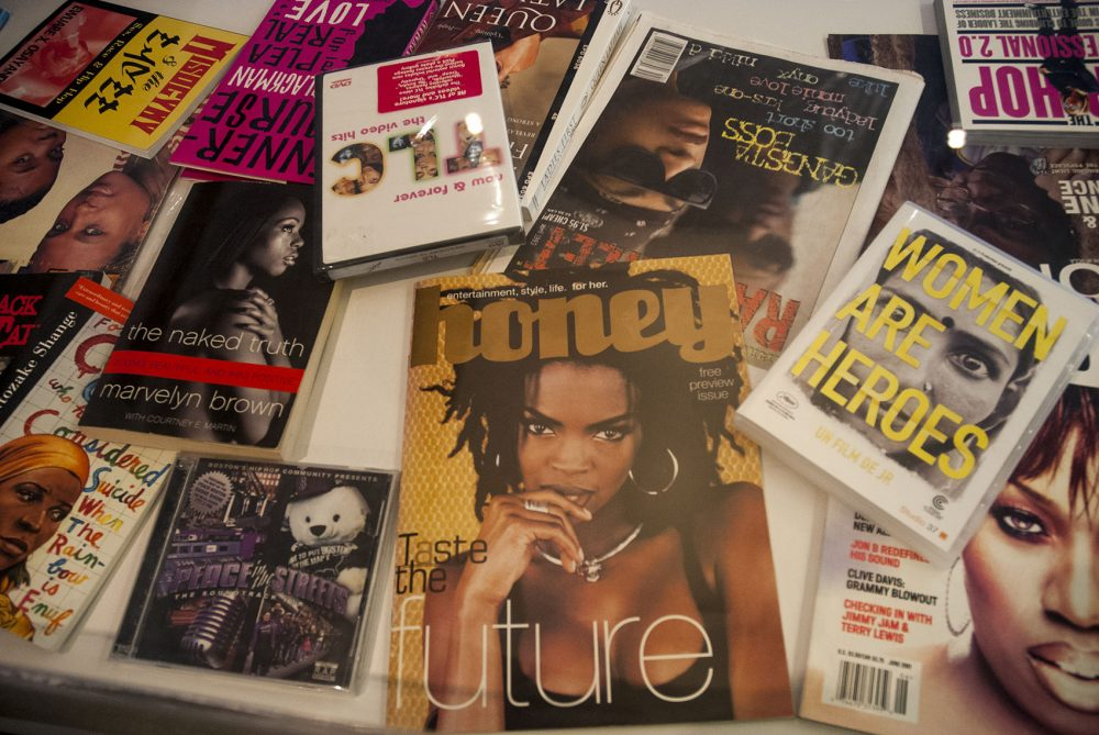 "A display case of women in hip-hop, including Lauryn Hill. Hill's album ""The Miseducation of Lauryn Hill"" is one of four placed in Harvard University's Loeb Library Music Archives in 2017. (Tonya Mosley/WBUR)"