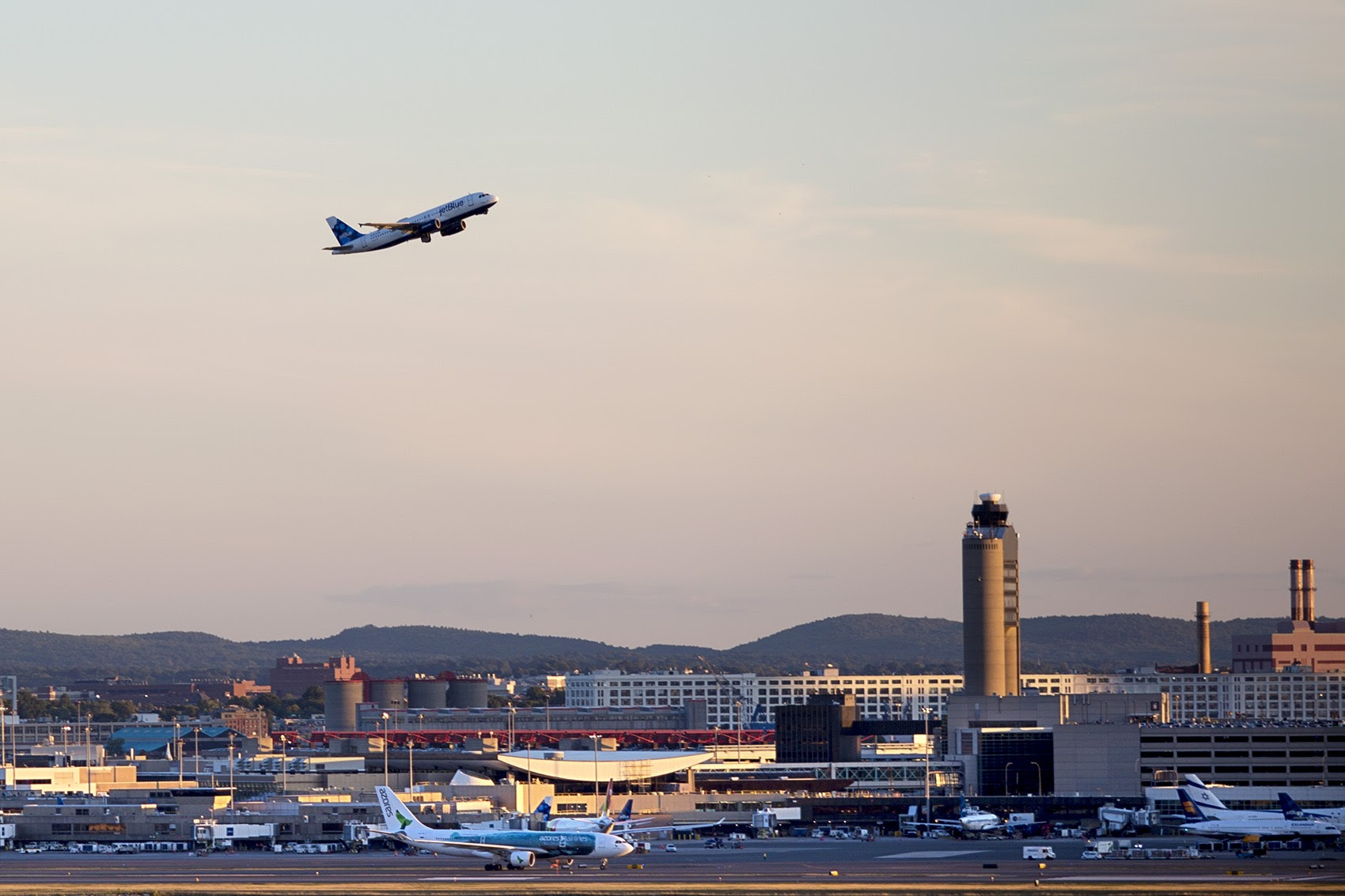 A Jet Blue airliner lifts off from Logan International Airport. (Jesse Costa/WBUR)