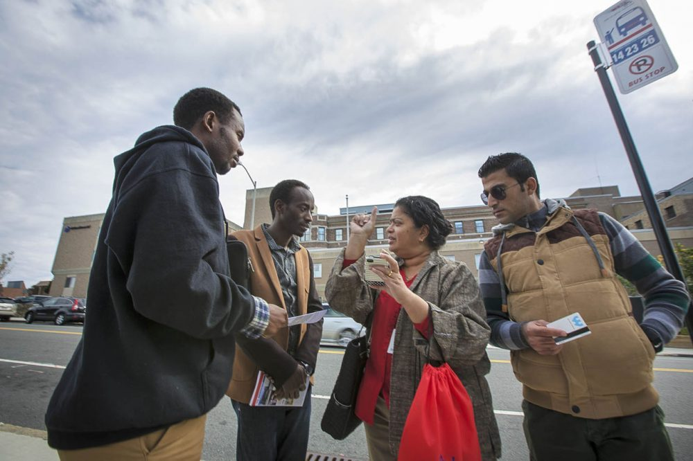 In Worcester, Ascentria Care Alliance offers a sort of one-stop shop for refugees. In this 2015 photo,, instructor Teresa Sebastian shows clients when the next WRTA bus will arrive using a phone app. (Jesse Costa/WBUR)