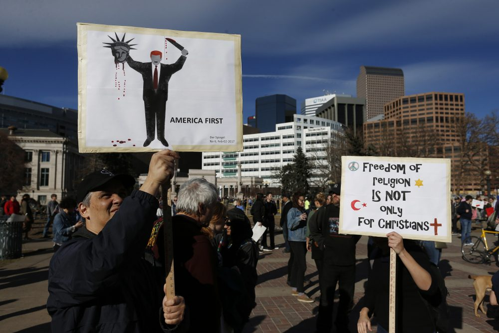 "Calling Trump ""chaotic"" and ""a pathological liar,"" influential publications around the world are advising their country's leaders to oppose him. Pictured: A man holds a sign depicting the cover of the German magazine Der Spiegel during a rally to protest President Donald Trump's executive order to temporarily ban some refugees from seven mostly Muslim countries, in Denver, Saturday, Feb. 4, 2017. (Brennan Linsley/AP)"