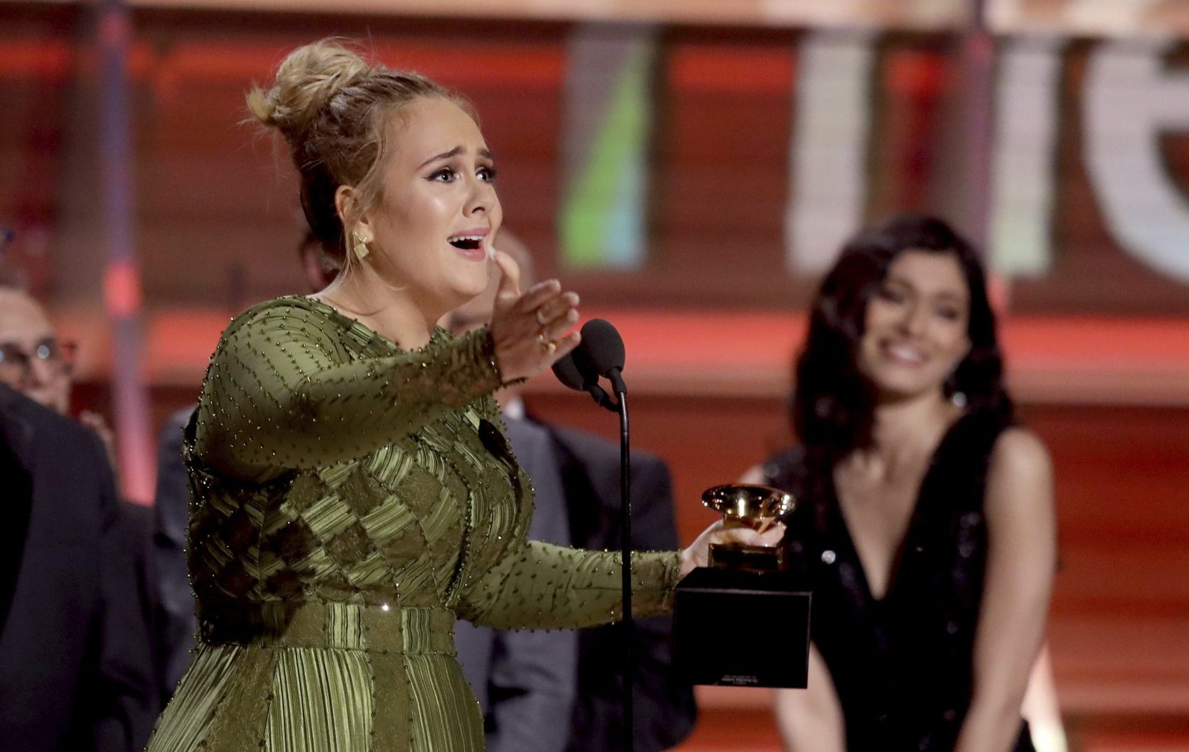"Adele accepts the award for Album of the Year for ""25"" at the Grammy Awards on Sunday. (Matt Sayles/Invision/AP)"