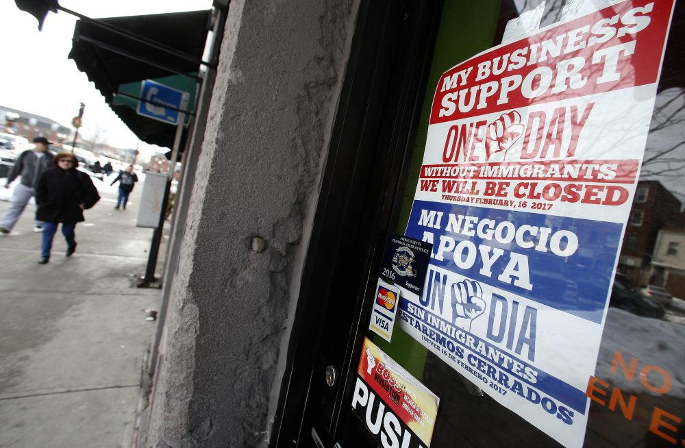 "A sign in support of ""A Day Without Immigrants"" is displayed in a closed business in the East Boston neighborhood of Boston, Thursday, Feb. 16, 2017. Immigrants around the U.S. stayed home from work and school Thursday to demonstrate how important they are to America's economy and its way of life, and many businesses closed in solidarity, in a nationwide protest called A Day Without Immigrants. (AP Photo/Michael Dwyer)"