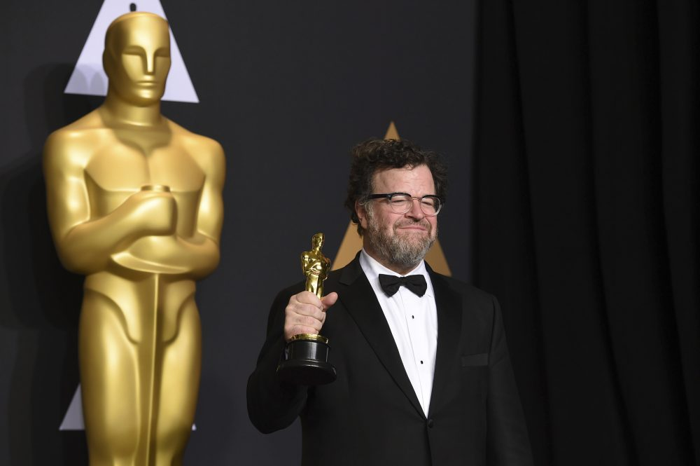 "Kenneth Lonergan poses in the press room with the award for best original screenplay for ""Manchester by the Sea"" at the Oscars on Sunday in Los Angeles. (Jordan Strauss/Invision/AP)"