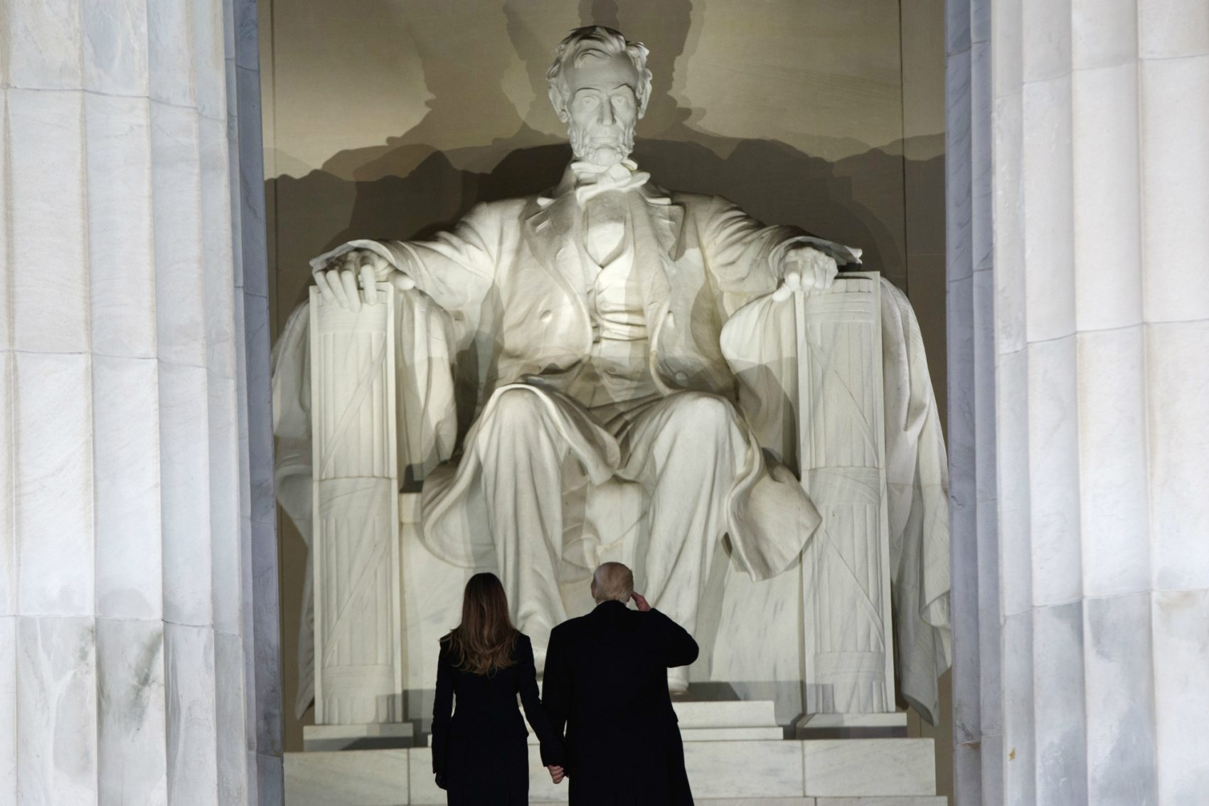 """Presidents' Day, writes Rich Barlow, is an apt time to reflect on Lincoln's lessons for the modern GOP, led by a president who pays lip service to his blue-collar base while pushing ideas that would hurt it. Pictured: President-elect Donald Trump, right, salutes as he arrives with his wife Melania Trump to the """"Make America Great Again Welcome Concert"""" at the Lincoln Memorial, Thursday, Jan. 19, 2017, in Washington. (Evan Vucci/AP)"""