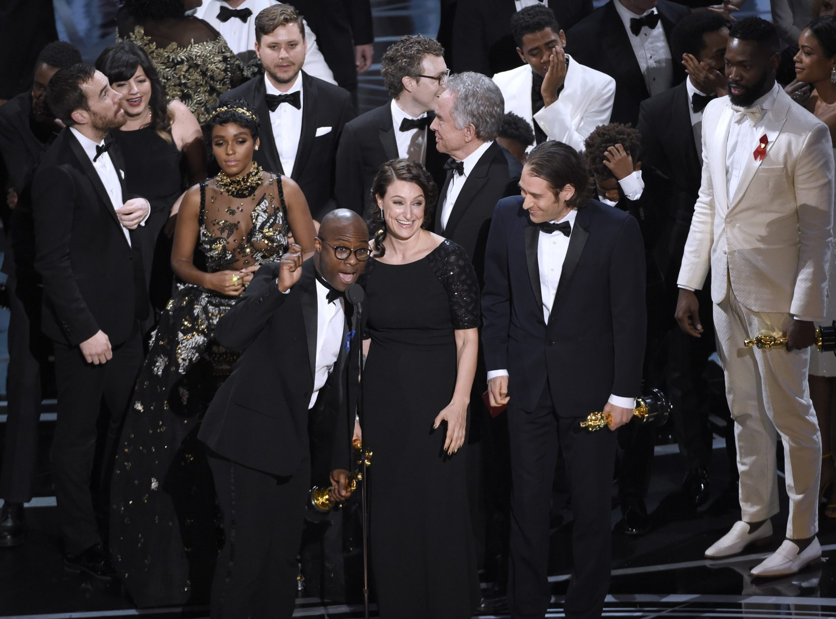 "Barry Jenkins and the cast of ""Moonlight"" accept the award for Best Picture. (Chris Pizzello/Invision/AP)"